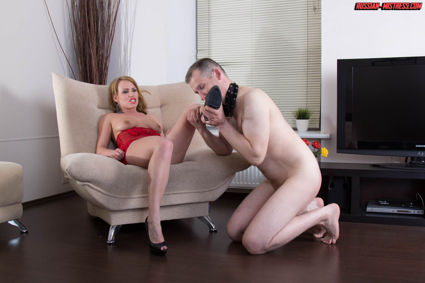 Picture #8 of Cruel bitch is loving wearing red lingerie and heels when pushing slave's face in between her butt cheeks and then peeing then over him