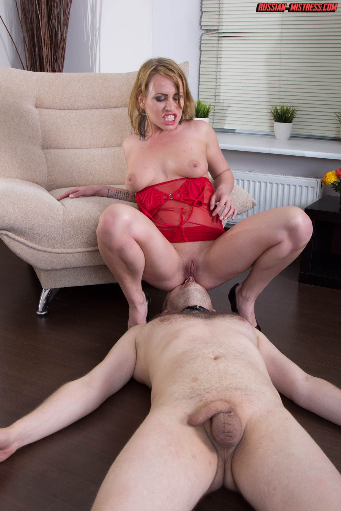 Picture #11 of Cruel bitch is loving wearing red lingerie and heels when pushing slave's face in between her butt cheeks and then peeing then over him