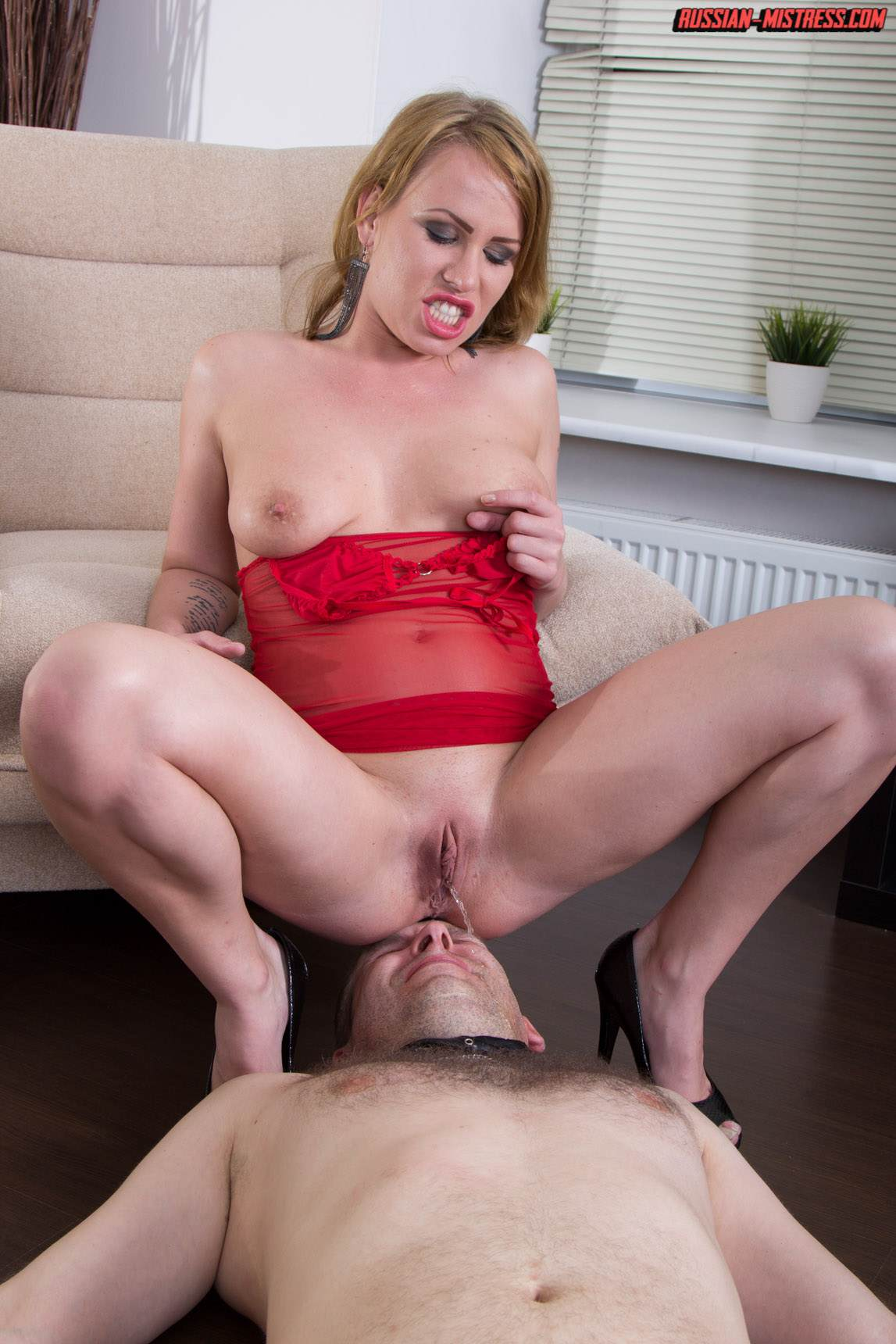 Picture #13 of Cruel bitch is loving wearing red lingerie and heels when pushing slave's face in between her butt cheeks and then peeing then over him