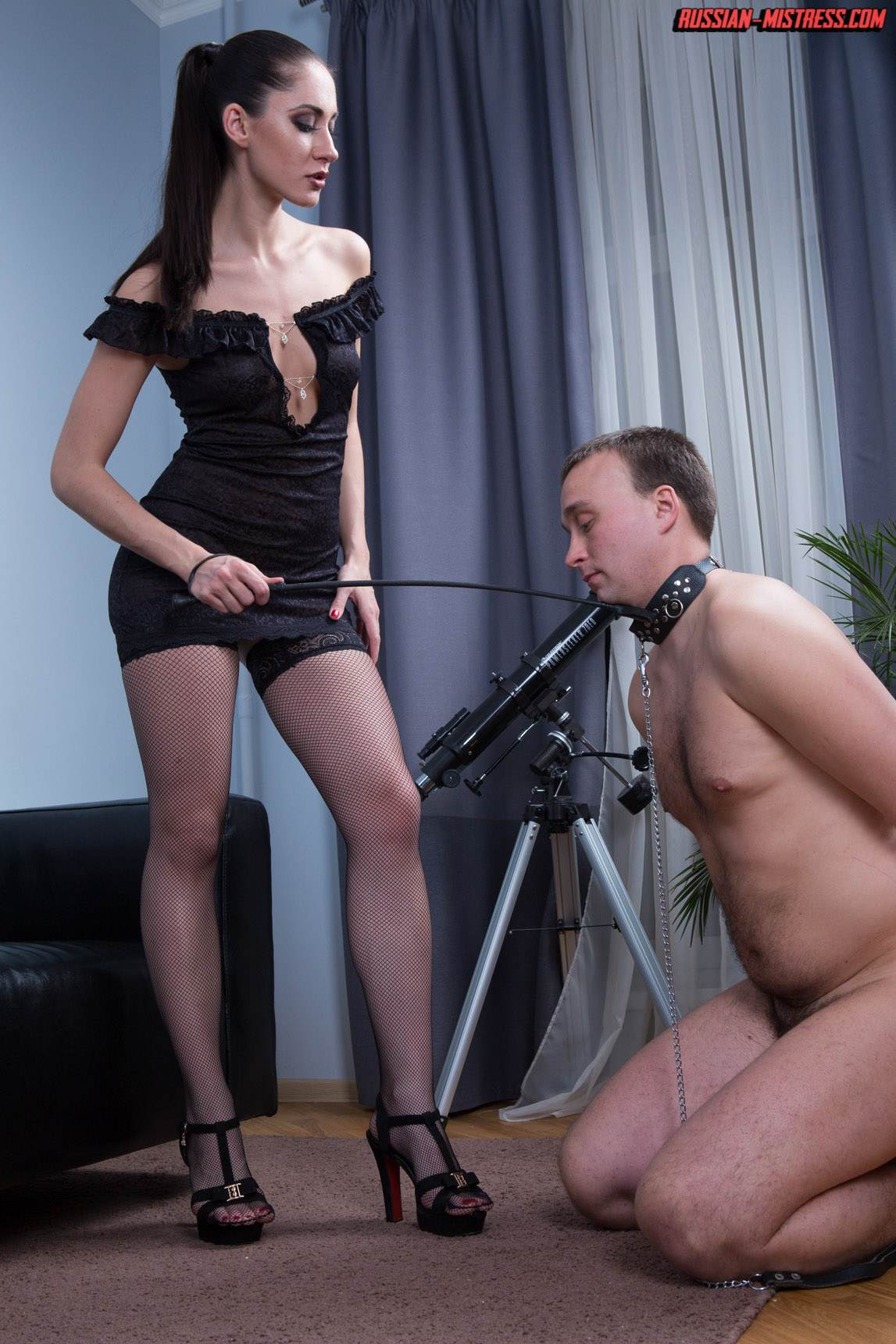 Picture #2 of Slut in fishnets is teaching kneeling man the proper way of serving pussy and ass with licking