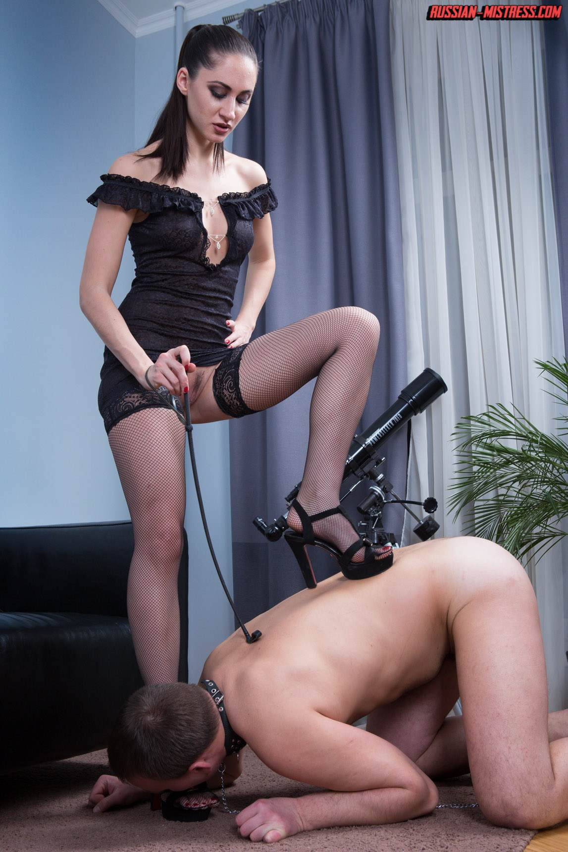 Picture #4 of Slut in fishnets is teaching kneeling man the proper way of serving pussy and ass with licking
