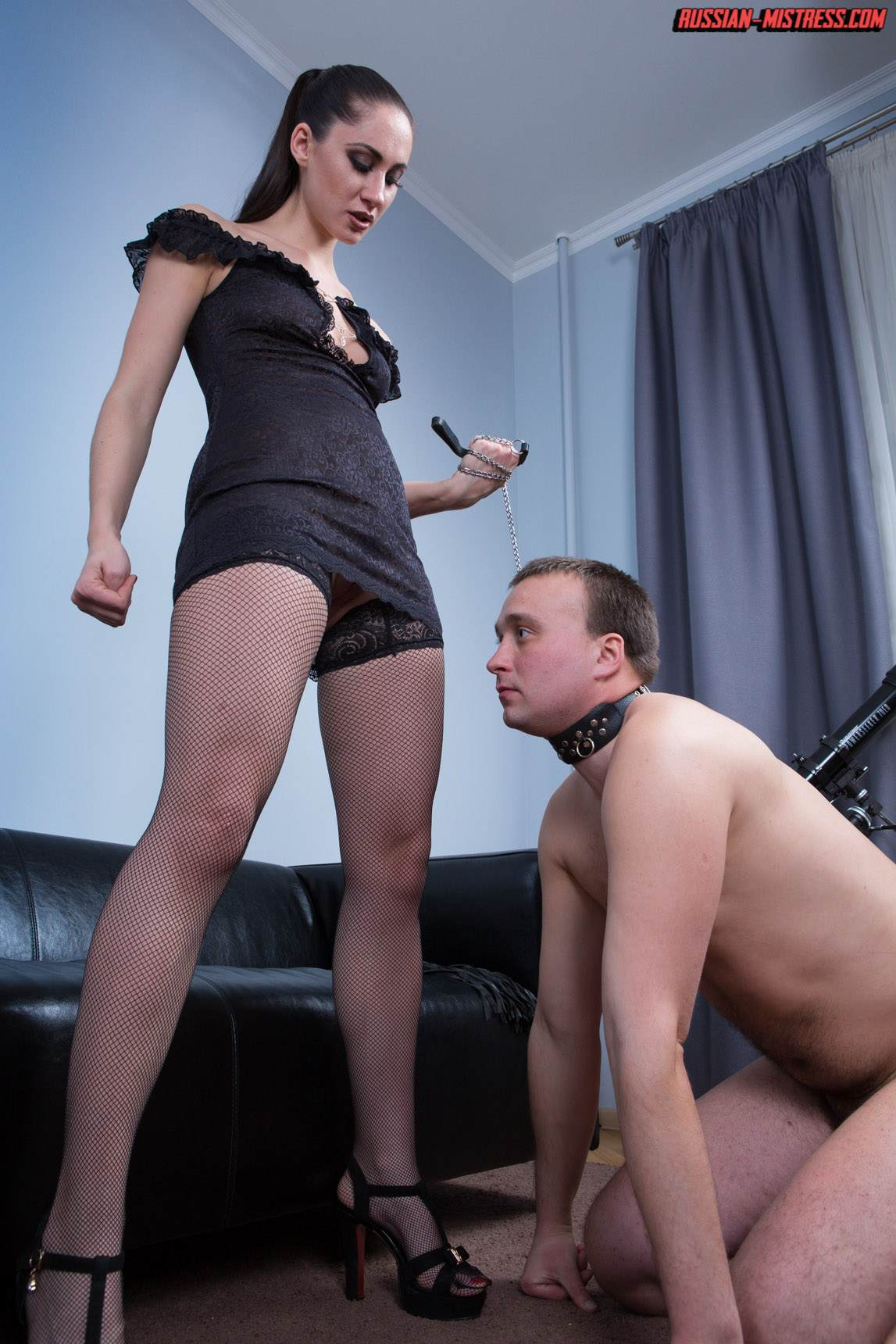 Picture #6 of Slut in fishnets is teaching kneeling man the proper way of serving pussy and ass with licking
