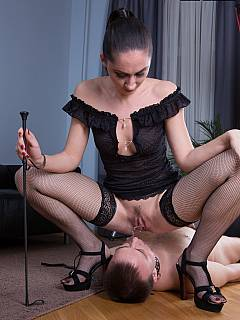 Slut in fishnets is teaching kneeling man the proper way of serving pussy and ass with licking