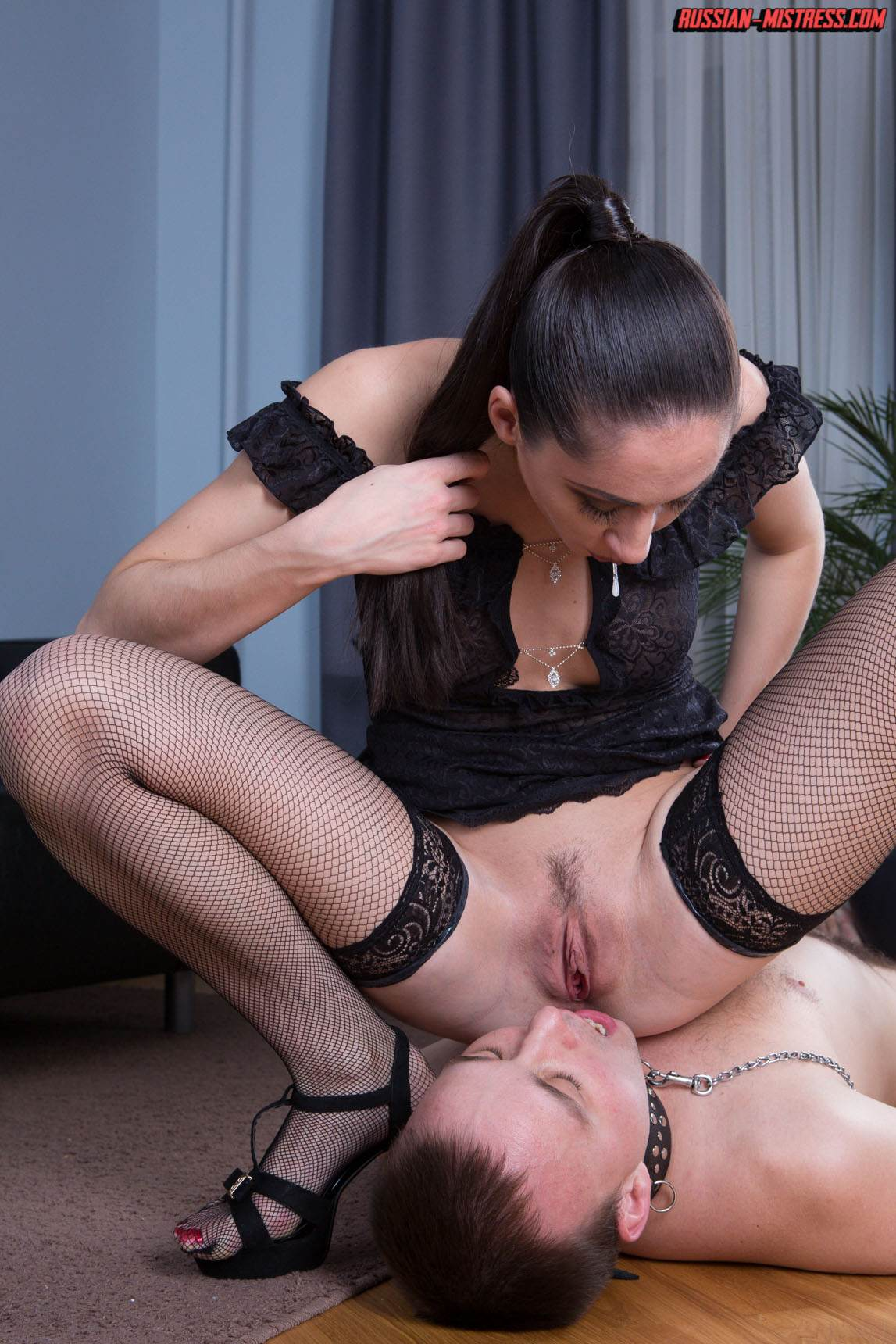 Picture #15 of Slut in fishnets is teaching kneeling man the proper way of serving pussy and ass with licking