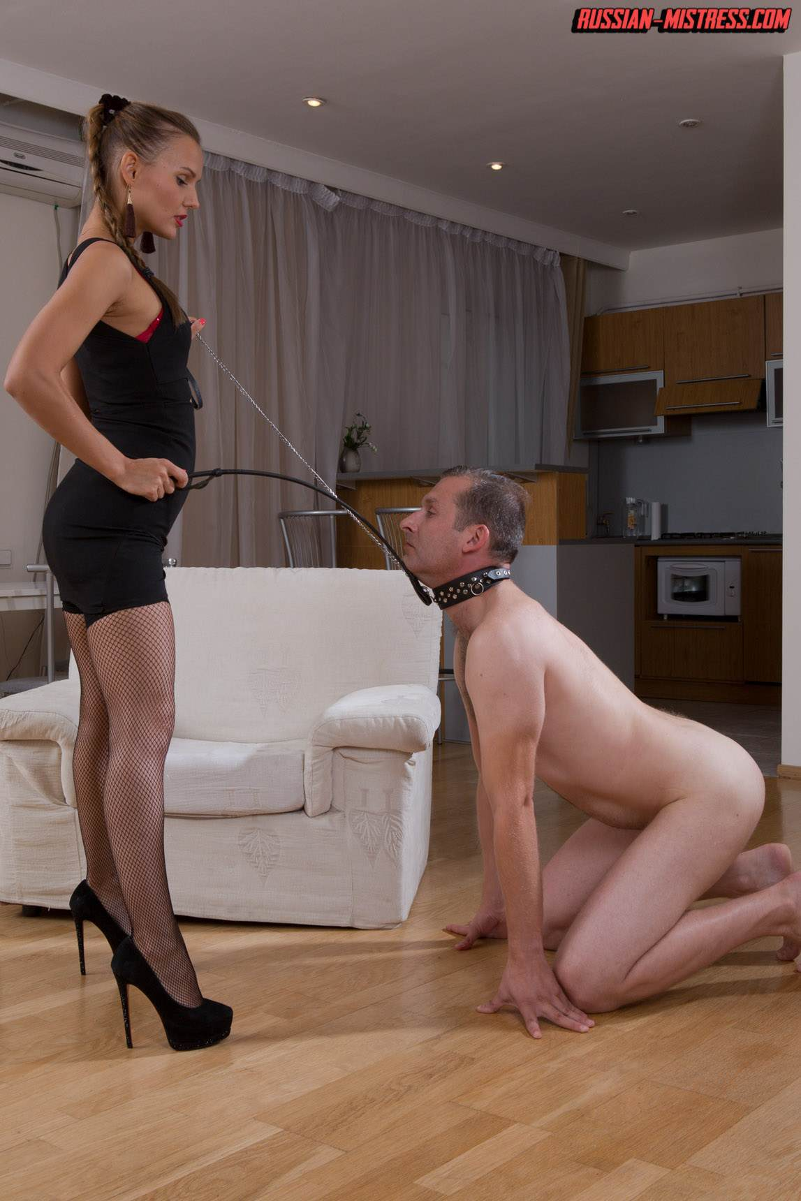 Picture #2 of Mistress is keeping slave motivated for legs worship with harsh whip lashes and then rewards him with deep anal strap-on penetration