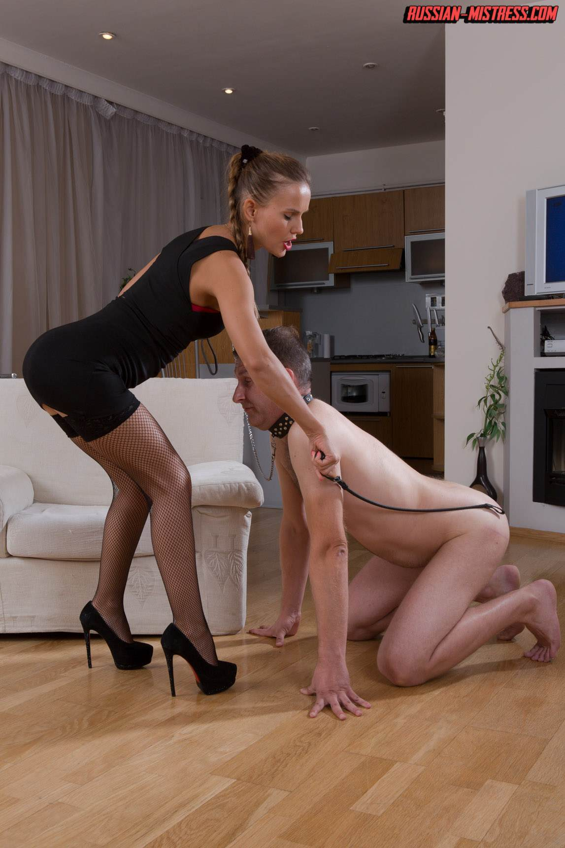 Picture #3 of Mistress is keeping slave motivated for legs worship with harsh whip lashes and then rewards him with deep anal strap-on penetration
