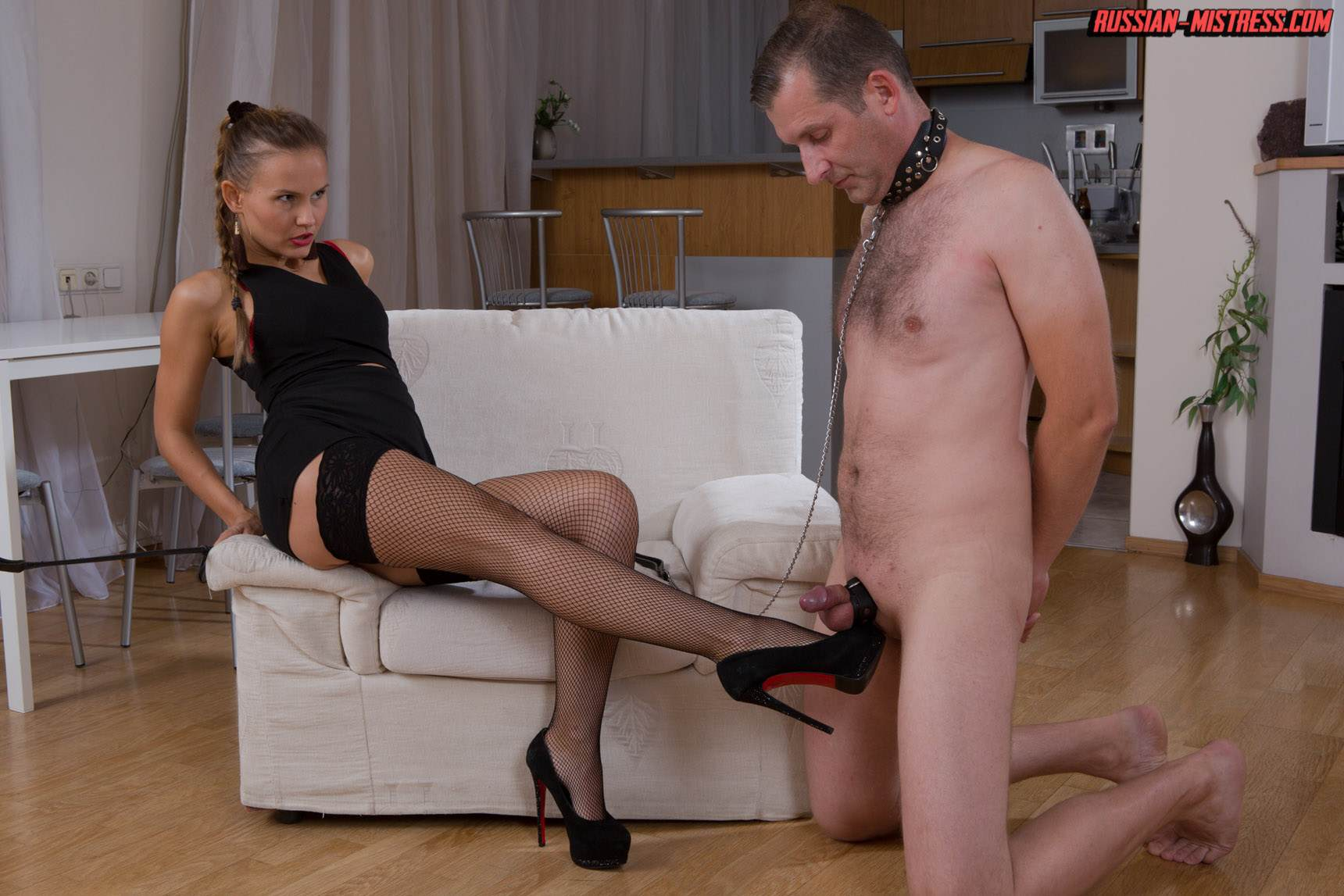 Picture #5 of Mistress is keeping slave motivated for legs worship with harsh whip lashes and then rewards him with deep anal strap-on penetration