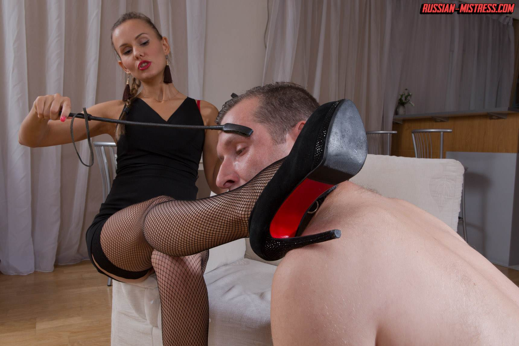 Picture #6 of Mistress is keeping slave motivated for legs worship with harsh whip lashes and then rewards him with deep anal strap-on penetration