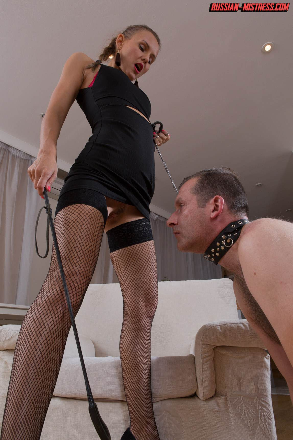 Picture #7 of Mistress is keeping slave motivated for legs worship with harsh whip lashes and then rewards him with deep anal strap-on penetration