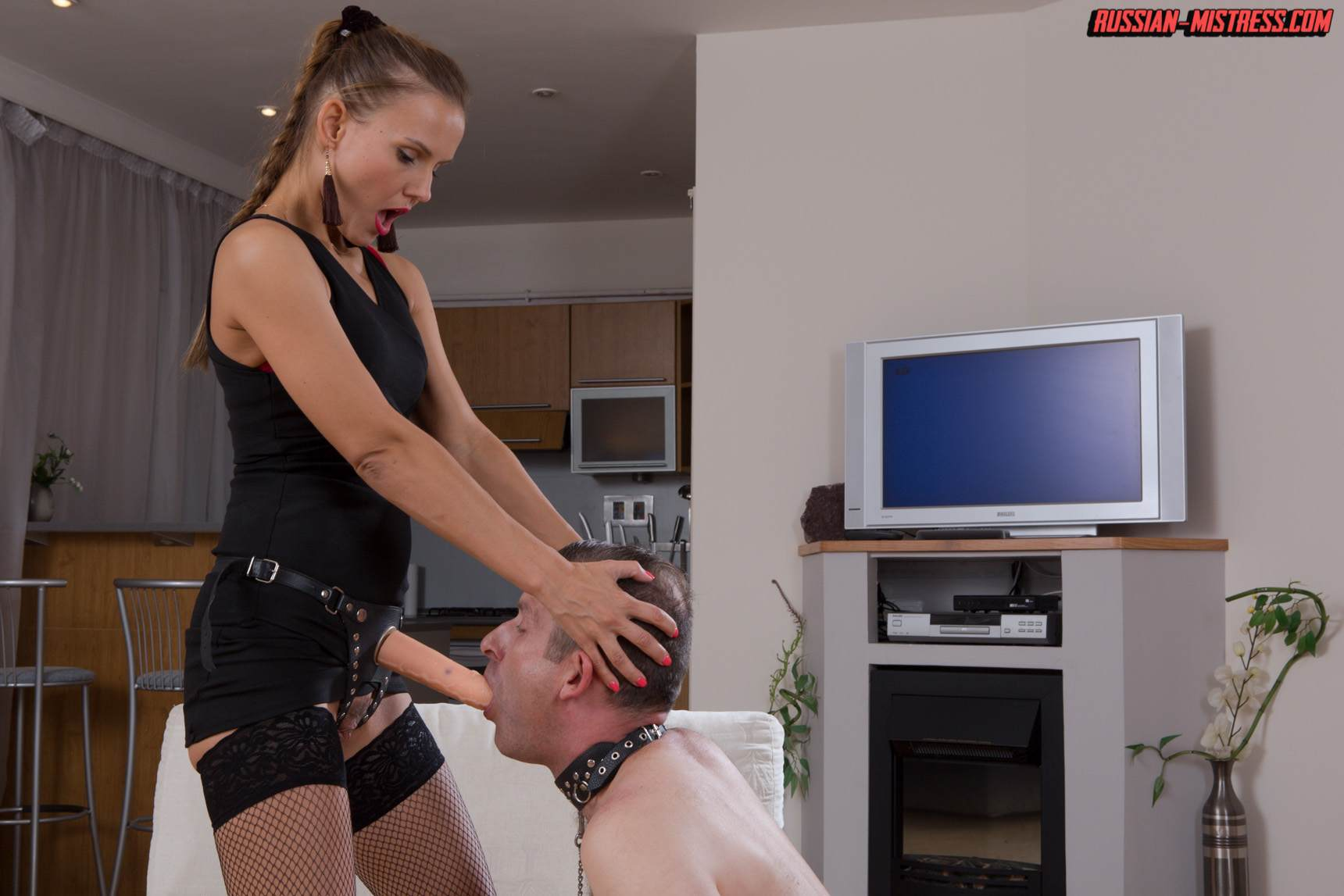 Picture #12 of Mistress is keeping slave motivated for legs worship with harsh whip lashes and then rewards him with deep anal strap-on penetration