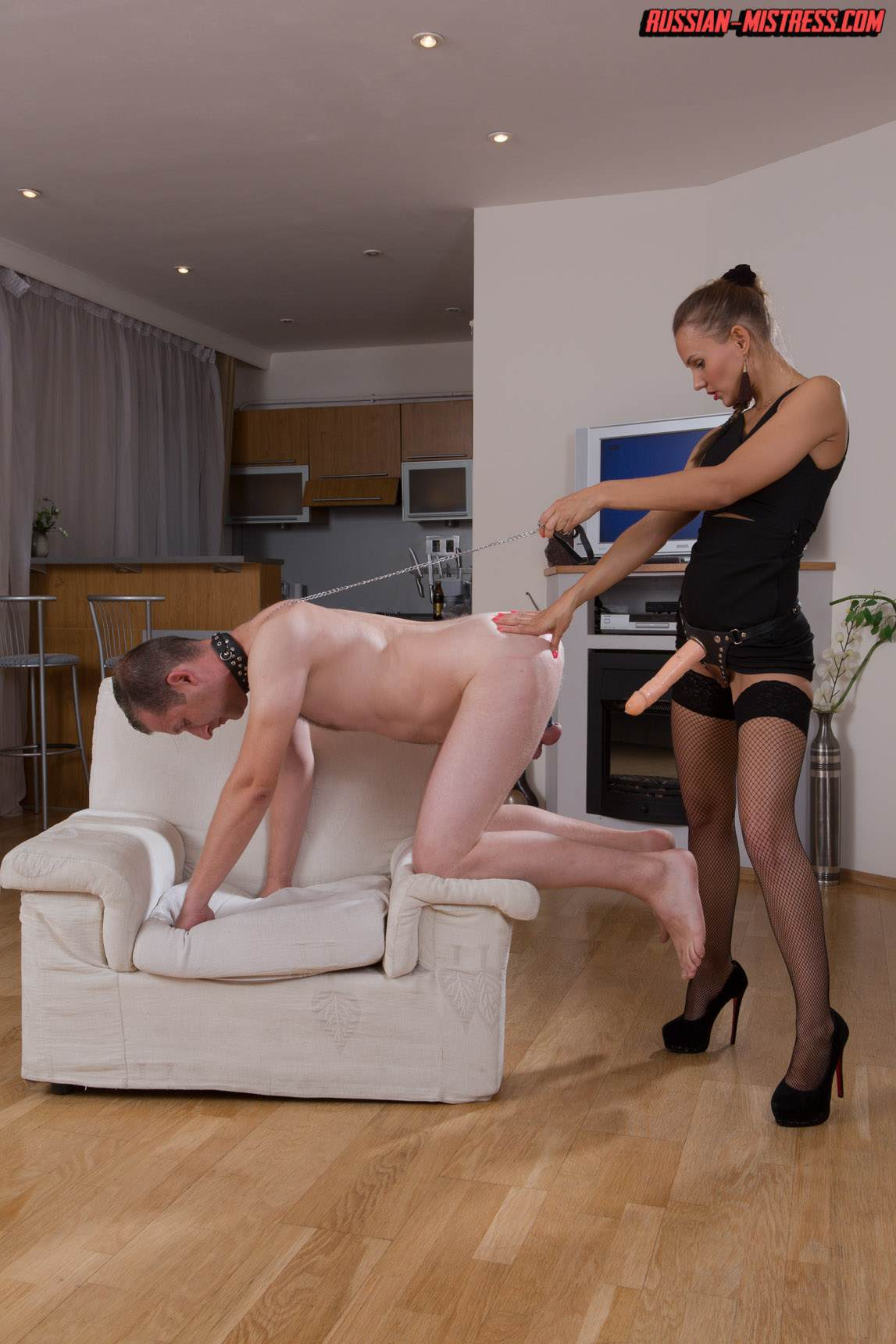 Picture #13 of Mistress is keeping slave motivated for legs worship with harsh whip lashes and then rewards him with deep anal strap-on penetration