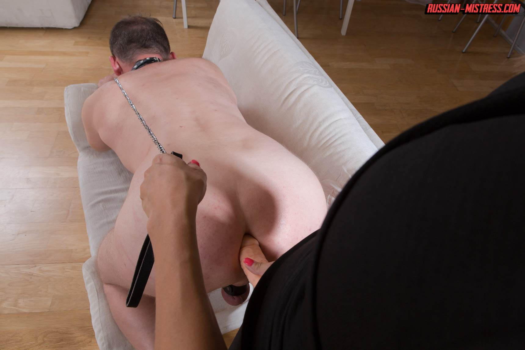 Picture #14 of Mistress is keeping slave motivated for legs worship with harsh whip lashes and then rewards him with deep anal strap-on penetration