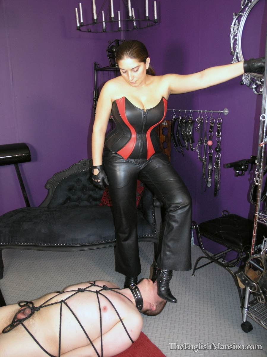 Picture #6 of Plump lady is all dressed up in leather and trampling a man after binding him helplessly with thin black rope