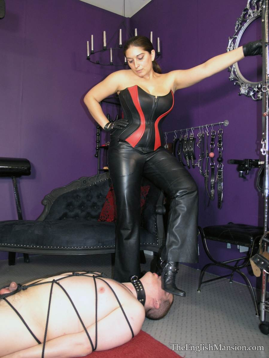Picture #7 of Plump lady is all dressed up in leather and trampling a man after binding him helplessly with thin black rope