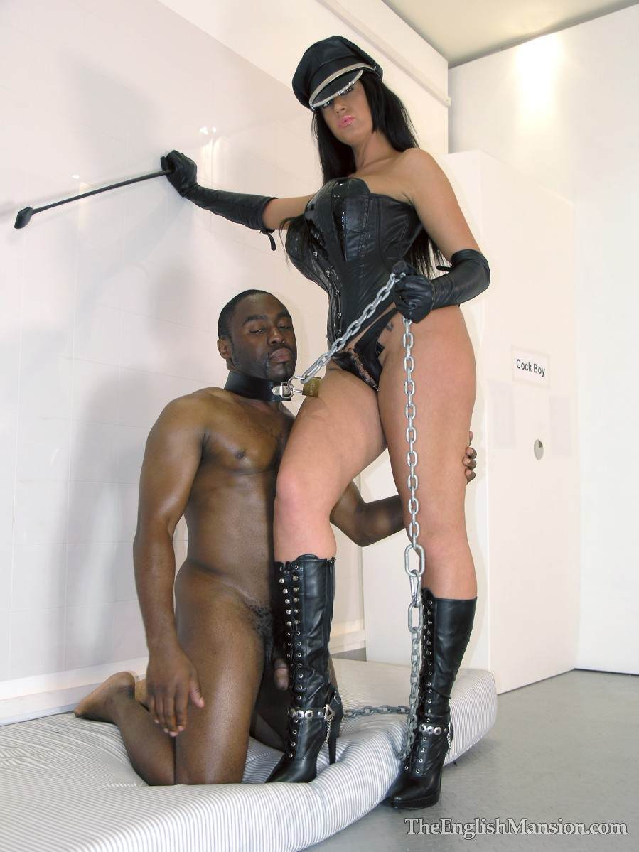 Picture #6 of Fetish Goddess is owning a black slave: controlling him with the leash during foot trampling and cock teasing