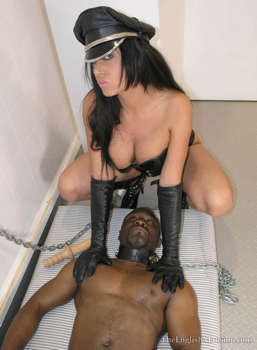Picture #9 of Fetish Goddess is owning a black slave: controlling him with the leash during foot trampling and cock teasing