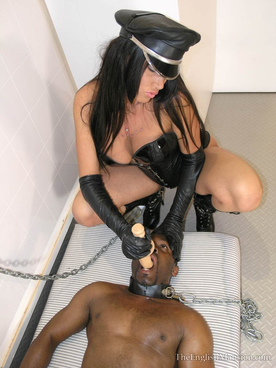 Picture #10 of Fetish Goddess is owning a black slave: controlling him with the leash during foot trampling and cock teasing