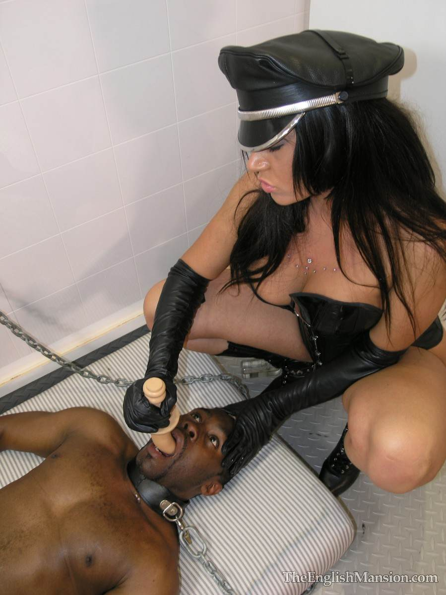 Picture #11 of Fetish Goddess is owning a black slave: controlling him with the leash during foot trampling and cock teasing