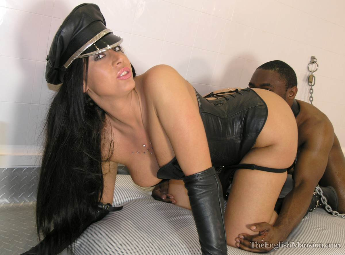 Picture #16 of Fetish Goddess is owning a black slave: controlling him with the leash during foot trampling and cock teasing