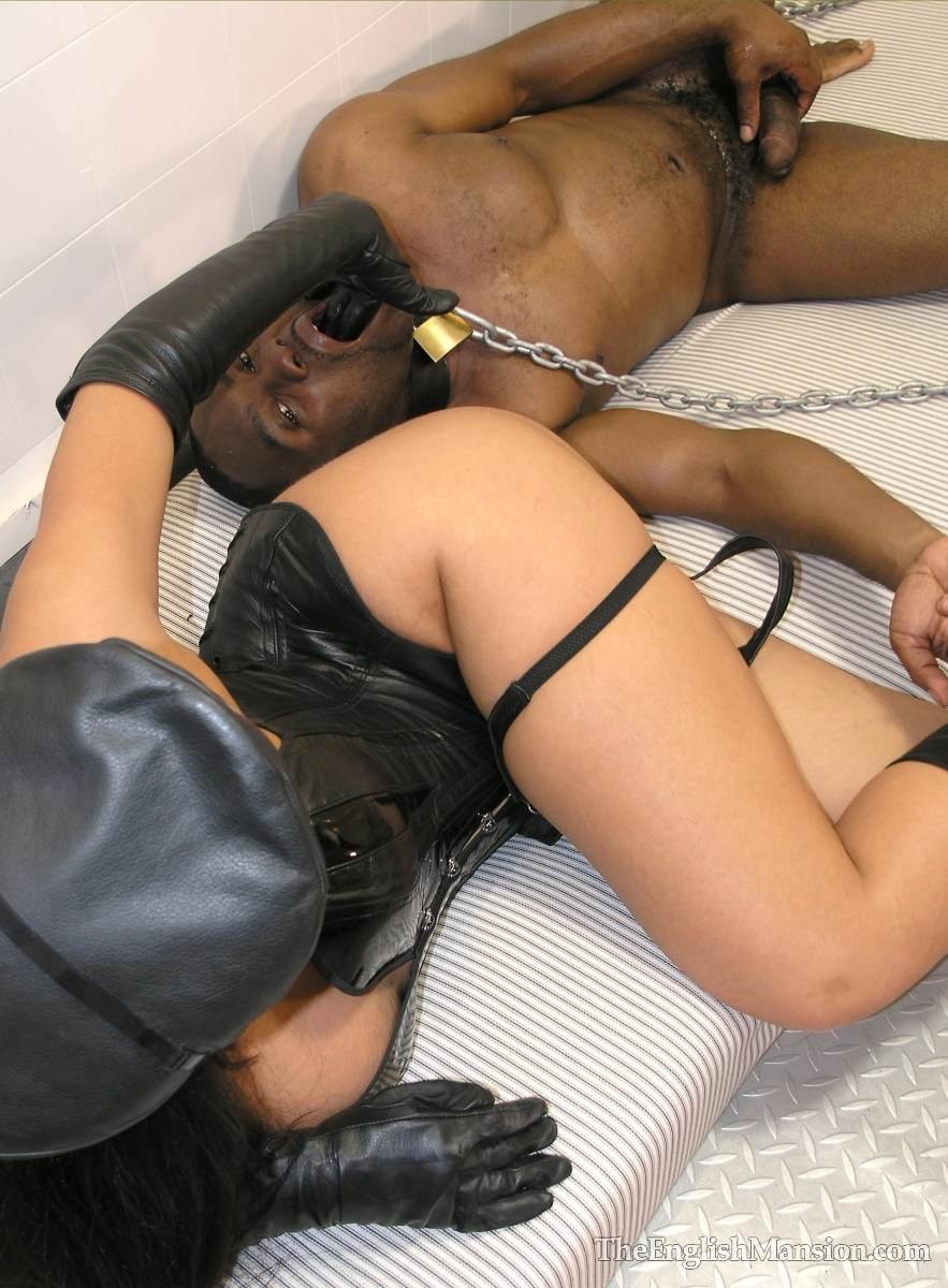 Picture #20 of Fetish Goddess is owning a black slave: controlling him with the leash during foot trampling and cock teasing