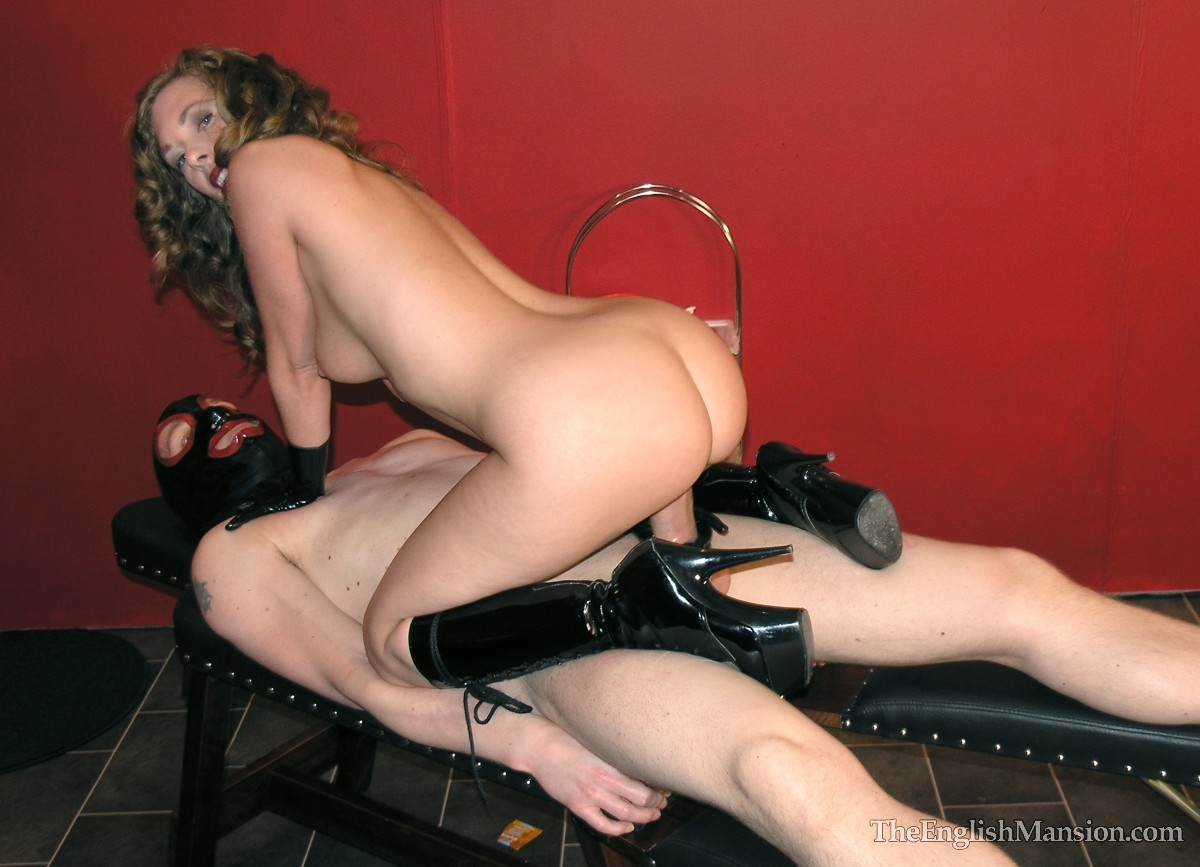 Picture #4 of Nude dominatrix is doing the tease with her wet pussy: rubbing penis hard but denying possible orgasms