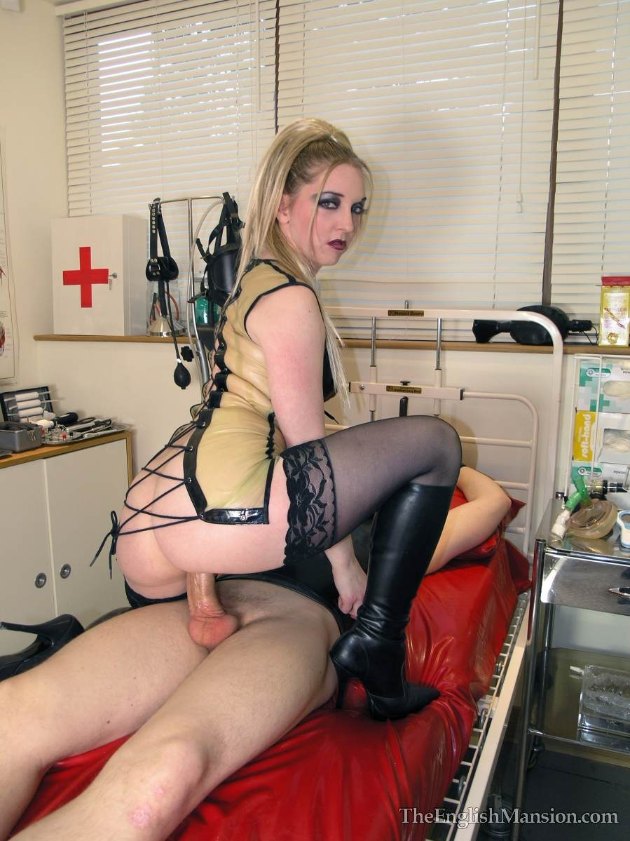 Picture #5 of Medical fetish mistress is keeping male cuffed to bed posts when she is fucking him with her cunt and licking cock but not allowing to cum
