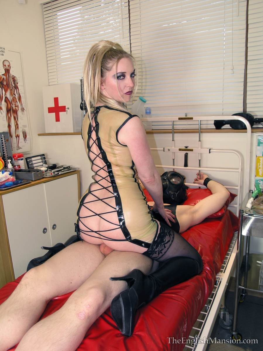 Picture #17 of Medical fetish mistress is keeping male cuffed to bed posts when she is fucking him with her cunt and licking cock but not allowing to cum