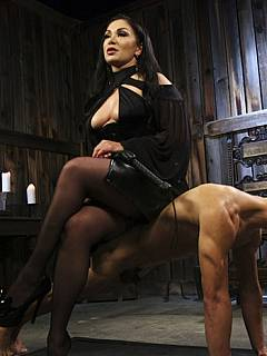 Lady in black is happy to have fresh femdom meat in her BDSM chamber to play with