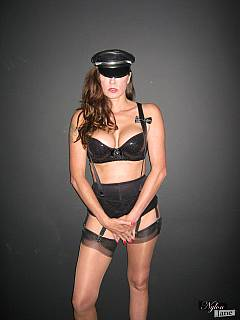 Erotic mistress in lingerie is transforming herself into military fetish bitch just by changing the hat