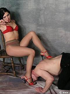 Tan pantyhose and red high heel shoes is the outfit that makes submissive man hard during foot worship scene
