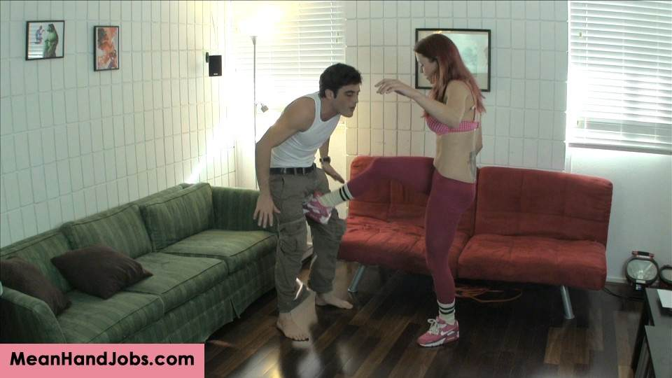 Picture #1 of Teasing redhead kicks man in the balls, pleasures herself with toy and then bangs his ass with a strap-on cock