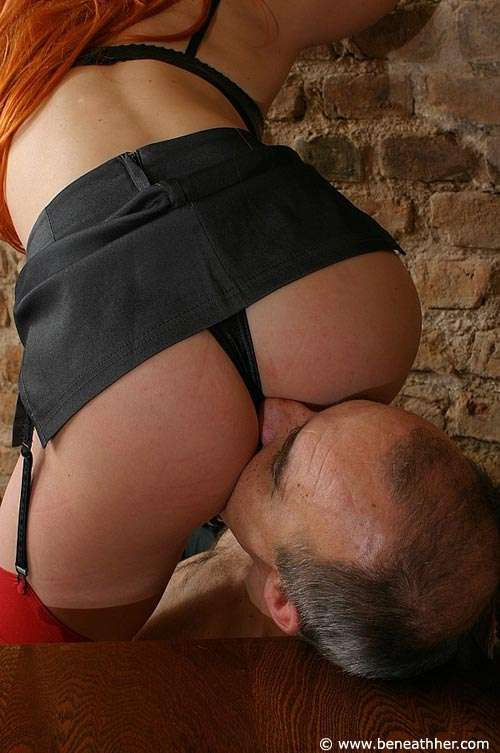 Picture #4 of Redhead is busy training a man into kinky pussy-licking human chair