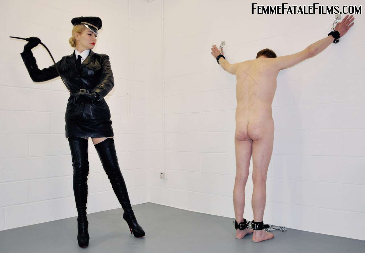 Picture #7 of Canning dominatrix is wearing military-style black leather uniform and a pair of knee-boots