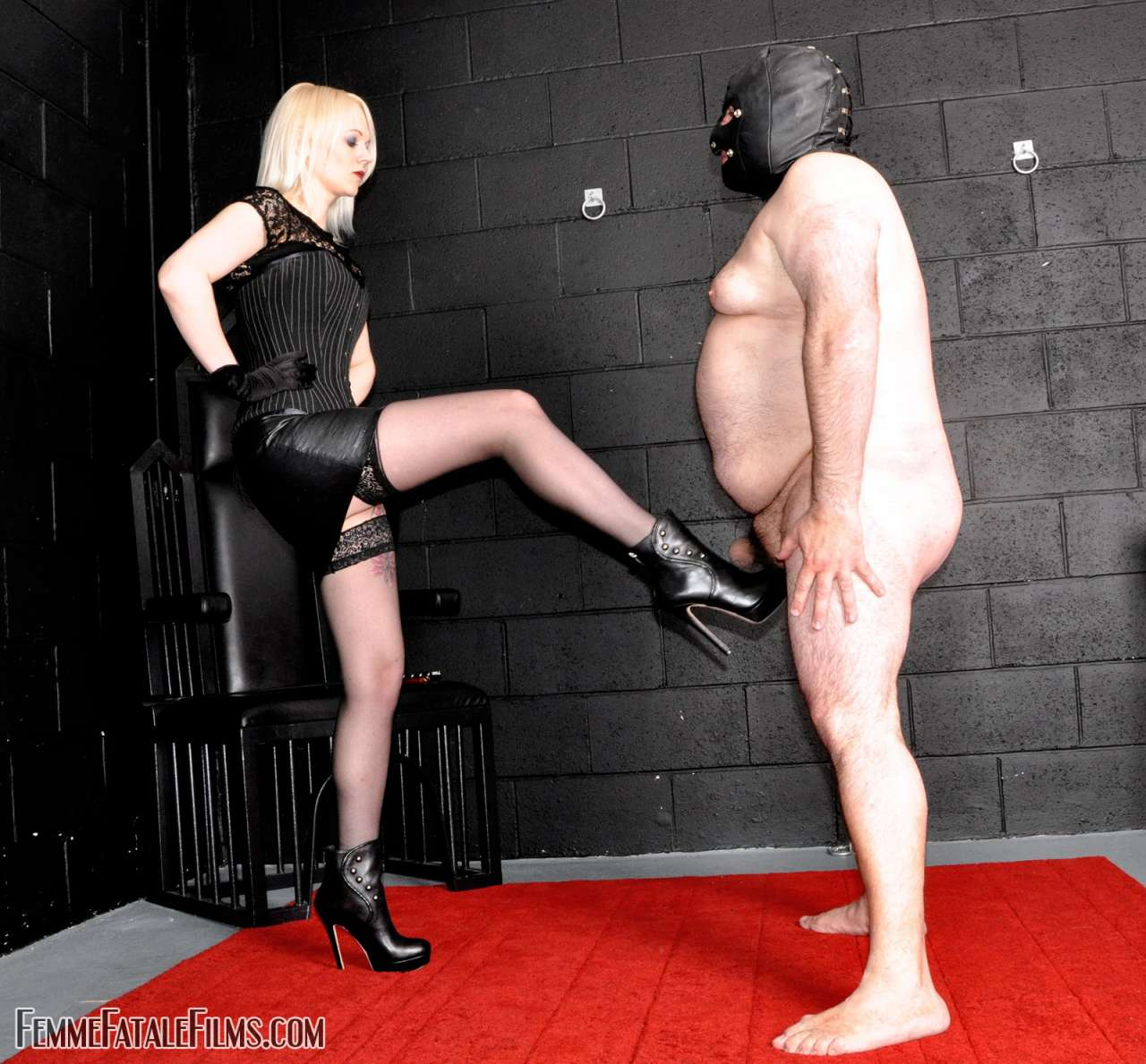 Picture #3 of Glamorous babe wants slave to worship her sexy feet after she kicked him in the balls a few times
