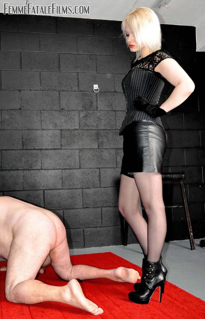 Picture #4 of Glamorous babe wants slave to worship her sexy feet after she kicked him in the balls a few times