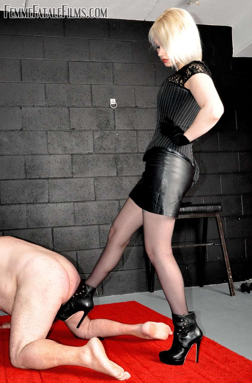 Picture #5 of Glamorous babe wants slave to worship her sexy feet after she kicked him in the balls a few times