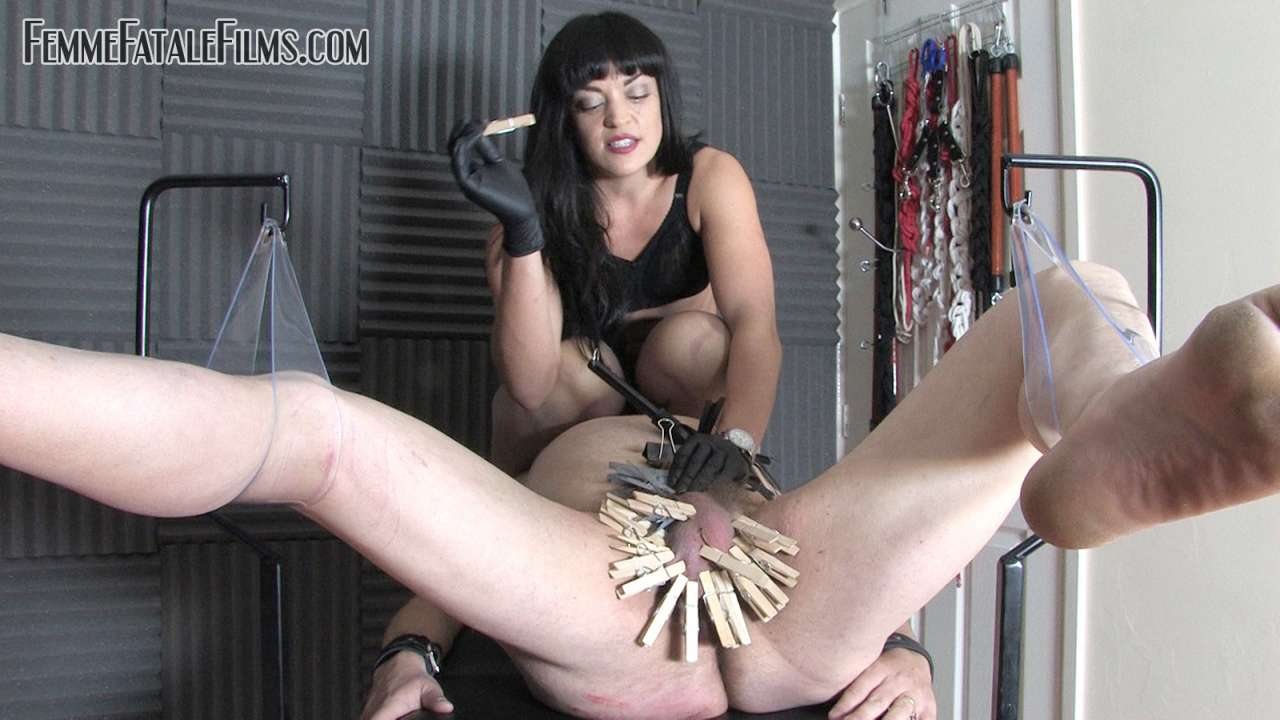 Picture #5 of Man is helpless when exposed in medical chair and cannot stoo bitchy domme tormenting his balls with multiple clothespegs