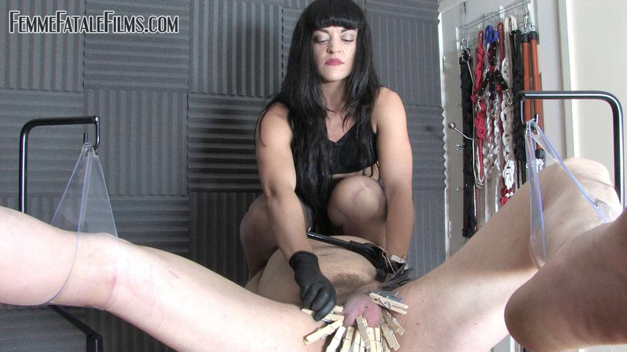 Picture #6 of Man is helpless when exposed in medical chair and cannot stoo bitchy domme tormenting his balls with multiple clothespegs