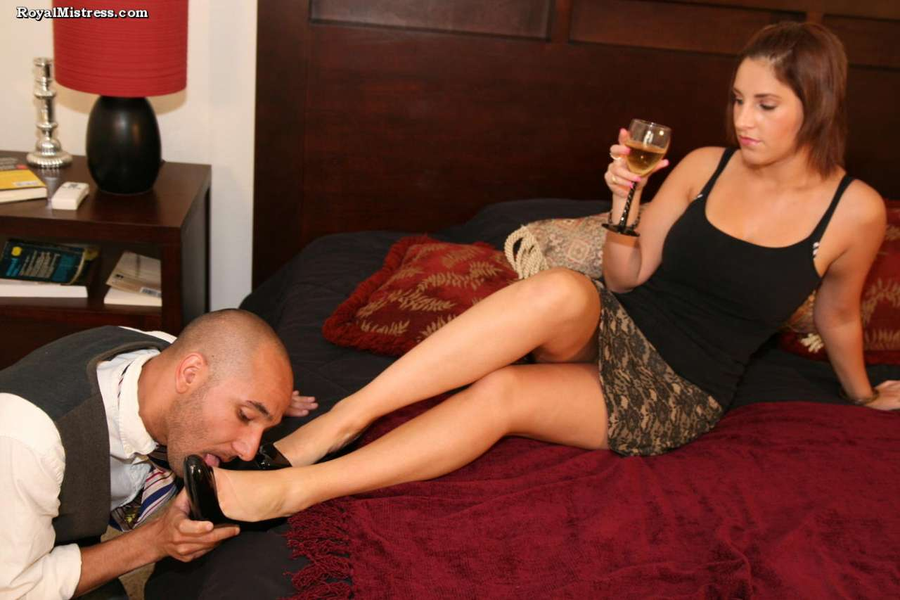 Picture #2 of Leggy babe is enjoying a glass of wine while bald male is worshiping her feet and smelling high heel shoes