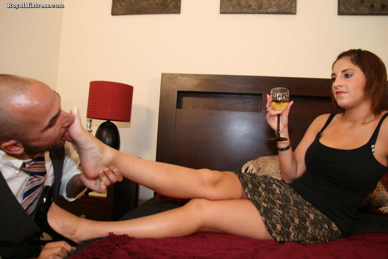 Picture #6 of Leggy babe is enjoying a glass of wine while bald male is worshiping her feet and smelling high heel shoes