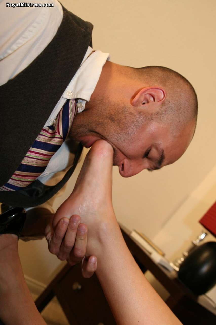 Picture #7 of Leggy babe is enjoying a glass of wine while bald male is worshiping her feet and smelling high heel shoes