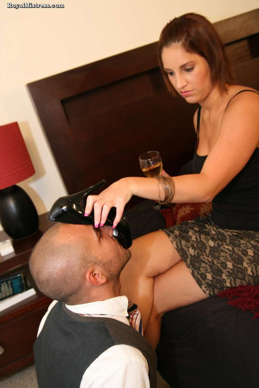 Picture #9 of Leggy babe is enjoying a glass of wine while bald male is worshiping her feet and smelling high heel shoes