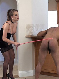 Busty dominatrix is putting her best efforts into cane strokes she is treating poor guy with