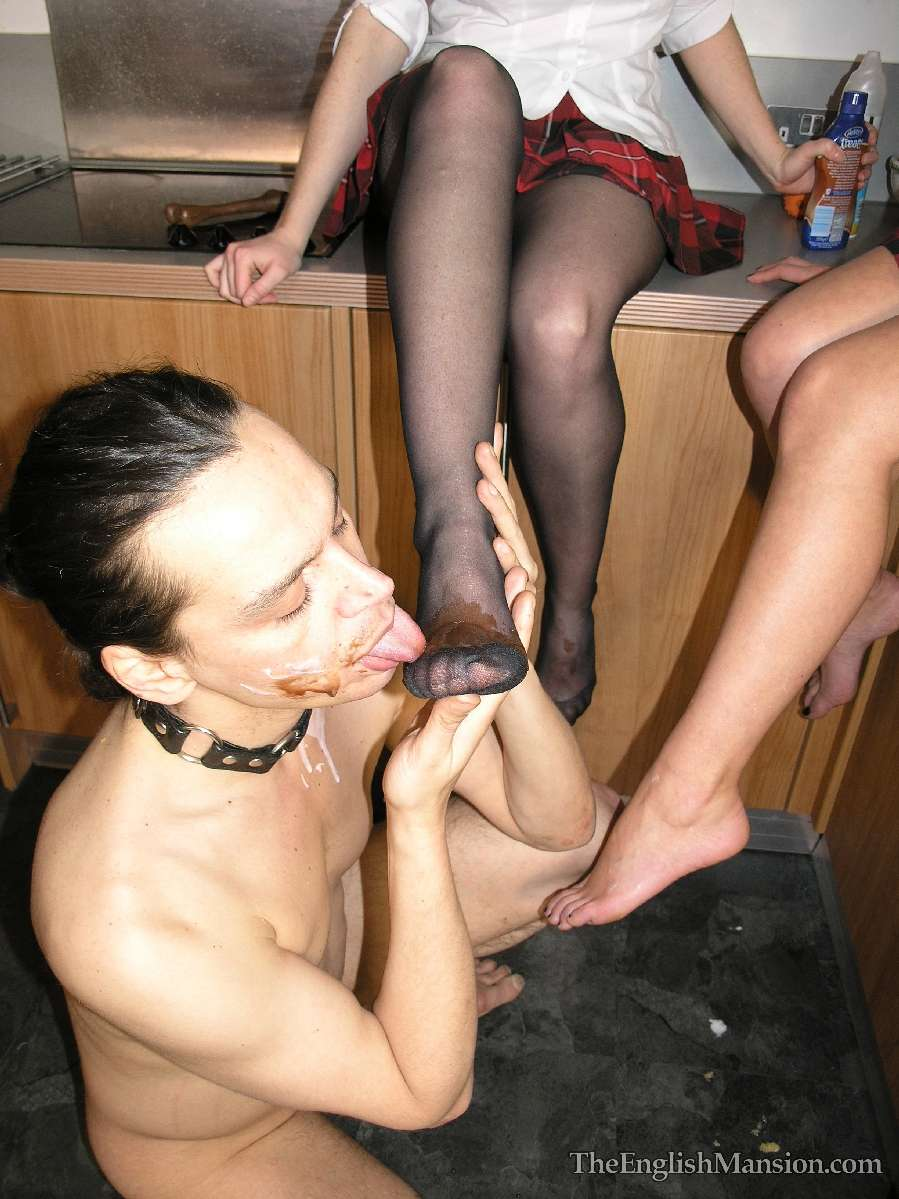 Picture #10 of Two sluts dressed up in college uniform are owning a petboy and training him to worship their feet