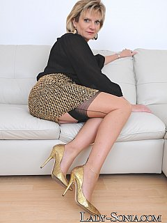 You can clearly see the sexy lingerie erotic MILF is wearing under that see-through blouse