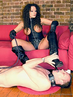 Curly dominatrix needs he boots to be clean and luckily there is just the foot-loving slave for the job