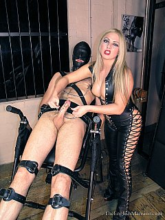 When strapped to BDSM rack, guys can do nothing to stop blond beauty tormenting his penis with clamps and wires