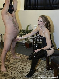Skinny bitch is knee-boots is making a man lick her pussy then clamps and pulls his manhood with the chain