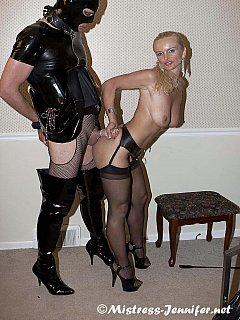 Sissy in PVC is getting teased by femdom blond when his cock is rubbed, licked but not allowed to ejaculate