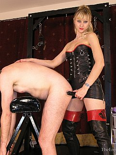 Blond dominatrix is doing her job of strap-on training nice and quiet making sure slave got both of his holes fucked hard
